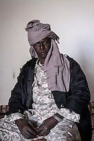 November 22, 2014 - Murzuq, Libya: REJAB AGEY, Tebu head of security, operational room, poses for photo in Murzuq. Fighting around Southwest Ubari region ignited after Tuareg militias from Mali and Libya sized control over the vast oilfield installations aligned with the Third Force of Misrata armed forces. Since then raged battles have taken place between two factions: one faction of Tuareg fighters lead by Third Force from Misrata pushing to clean the region from the other faction of Tebu tribal fighters defending their controlled territory. (Photo/Narciso Contreras)