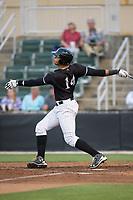 Antonio Rodriguez (14) of the Kannapolis Intimidators follows through on his swing against the Augusta GreenJackets at Kannapolis Intimidators Stadium on May 3, 2017 in Kannapolis, North Carolina.  (Brian Westerholt/Four Seam Images)