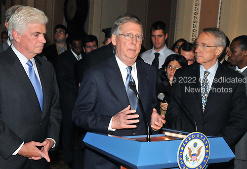 Washington, DC - October 1, 2008 -- United States Senator Mitch McConnell (Republican of Kentucky), the Minority Leader, makes a statement to reporters outside the United States Senate Chamber in the United States Capitol after casting votes to pass the 700 billion dollar Wall Street bail-out package in Washington, D.C. on Wednesday, October 1, 2008.  At left is United States Senator Chris Dodd (Democrat of Connecticut) and at right is United States Senator Harry Reid (Democrat of Nevada), the Majority Leader..Credit: Ron Sachs / CNP.(RESTRICTION: NO New York or New Jersey Newspapers or newspapers within a 75 mile radius of New York City)