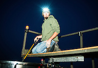 Brett Buettner (cq) with team Brainem, from Nebraska, chooses carp for his weigh in, after the U.S. Open Bowfishing Championship, Sunday, May 4, 2014. <br /> <br /> Photo by Matt Nager