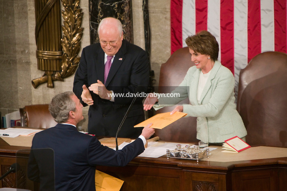 23 January 2007 - Washington, DC - US President George W. Bush (2L) hands a copy of his speech to Speaker of the House Nancy Pelosi (R) as Vice-President Cheney (2R) looks on, at the start of his State of the Union speech in Washington, DC, USA, 23 January 2007.