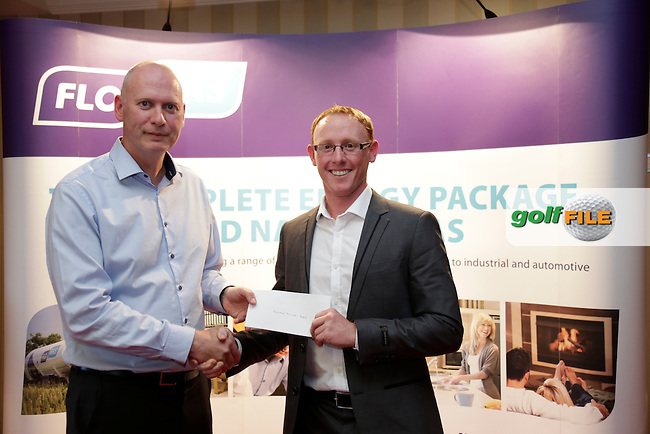 Graeme Dunlea receives his prise from with John Rooney Flo Gas for his win in the Flo Gas Pro - Am Knightsbrook Golf Club, Trim, Co Meath.<br />