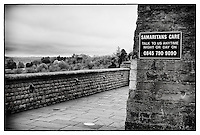Clifton Suspension Bridge, Bristol, with Samaritans sign on wall.