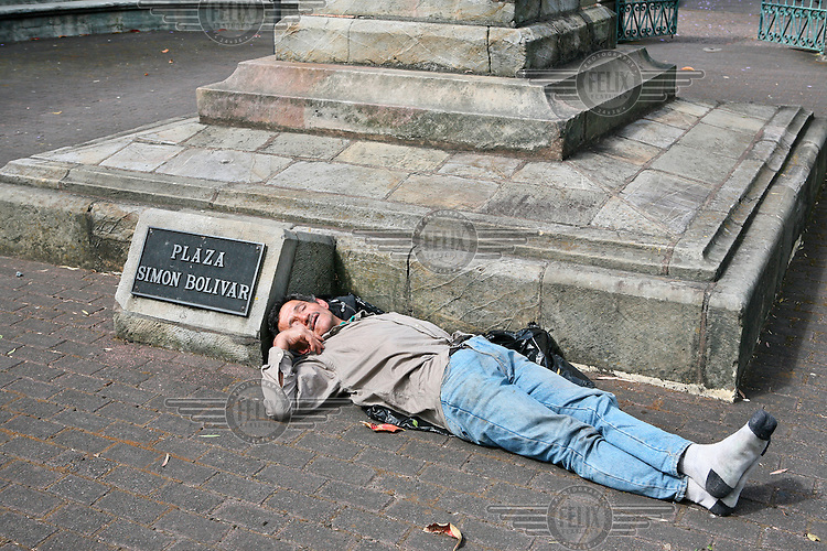 A homeless man sleeping on the Plaza Simon Bolivar in the capital San Jose.