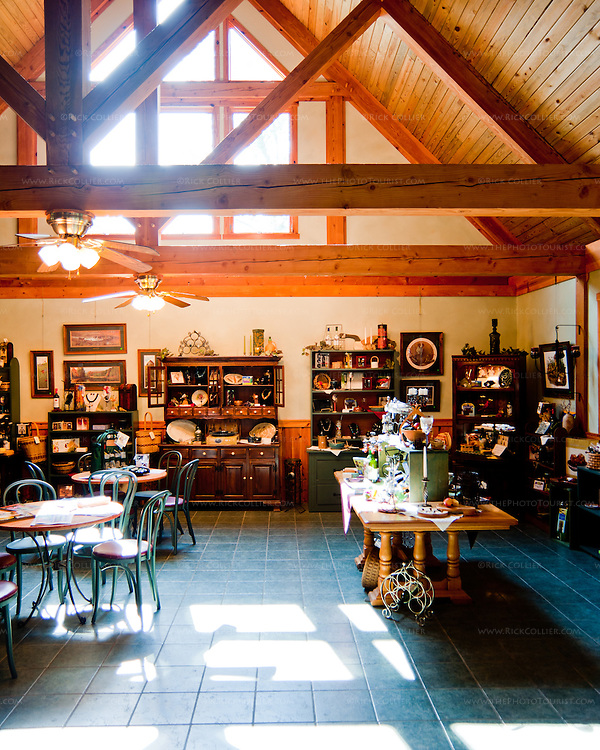 The tasting room at Oak Crest Vineyard and Winery features lots of open seating, with souvenirs and wine-related goods for sale around the walls.