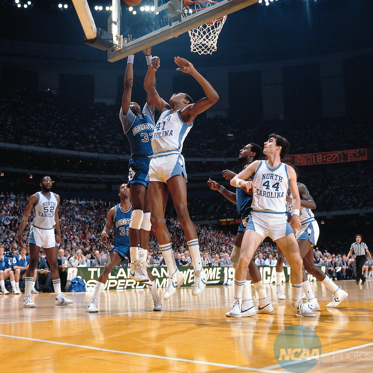 29 MAR 1982:  Georgetown center Pat Ewing (33) and North Carolina center Sam Perkins (41) during the NCAA Men's National Basketball Final Four championship game held in New Orleans, LA, at the Superdome. North Carolina defeated Georgetown 63-62 for the championship. Rich Clarkson/NCAA PhotosSI CD 0025-20