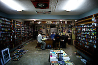 The owner of the Jazz Hole, a prominent record store, ( in a blue shirt ) talks with good friends about music after closing the store in Nigeria's capital Lagos on Saturday March 28 2009..