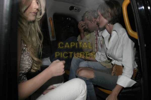 JASMINE LENNARD & FRIENDS.Leaving Cipriani Restaurant,.London, 14th September 2005.half length taxi white shirt ripped denim jeans knee.Ref: AH.www.capitalpictures.com.sales@capitalpictures.com.© Capital Pictures.