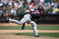 OAKLAND, CA - JUNE 30:  Josh Tomlin #43 of the Cleveland Indians pitches against the Oakland Athletics during the game at the Oakland Coliseum on Saturday, June 30, 2018 in Oakland, California. (Photo by Brad Mangin)