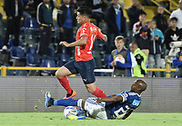 BOGOTA - COLOMBIA, 04-08-2018: Felipe Banguero Millan (Der) jugador de Millonarios disputa el balón con German Cano (Izq) jugador de Deportivo Independiente Medellín durante partido por la fecha 3 de la Liga Águila II 2018 jugado en el estadio Nemesio Camacho El Campin de la ciudad de Bogotá. / Felipe Banguero Millan (R) player of Millonarios fights for the ball with German Cano (L) player of Deportivo Independiente Medellin during the match for the date 3 of the Liga Aguila II 2018 played at the Nemesio Camacho El Campin Stadium in Bogota city. Photo: VizzorImage / Gabriel Aponte / Staff.