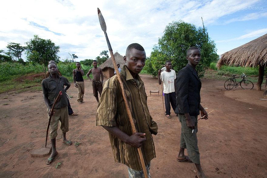 10 May 2010 - Yambio, Western equatoria State, South Sudan - Arrow Boys patrolling. Western Equatoria State has suffered years of attacks by the Lord's Resistance Army. Thousands of civilians have been displaced and hundreds killed or abducted in the border area between Southern sudan, DRC and the Central African Republic. In the absence of an effective response by the Sudanese government to the Lord's Resistance Army, many local men and boys have organized self-defense forces known as the Arrow Boys who battle the relatively well-armed LRA with traditional weapons such as bows, arrows, spears and clubs, treated with poisonous. Initially the self defense force was at a small scale, and it grew up in September 2009 when backlash attacks started to kill, loot, burn houses and rape the villagers. Today, the Arrow boys played a brave and crucial role by taking in charge the protection of their villages. Photo credit: Benedicte Desrus
