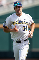 Michigan Wolverines pitcher Jack Bredeson (34) before Game 1 of the NCAA College World Series against the Texas Tech Red Raiders on June 15, 2019 at TD Ameritrade Park in Omaha, Nebraska. Michigan defeated Texas Tech 5-3. (Andrew Woolley/Four Seam Images)