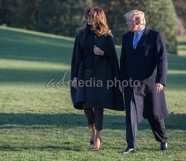 United States President Donald J. Trump and First Lady Melania Trump return to the White House after attending the funeral service of Rev. Billy Graham and a Republican Fundraiser at Mar-a-Lago, Florida. <br /> Credit: Chris Kleponis / Pool via CNP