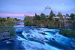 Washington, Spokane, Riverfront Park. Moon rise over the Pavillion remaining from EXPO 74 world's fair, and rapids on the Spokane River above the falls.
