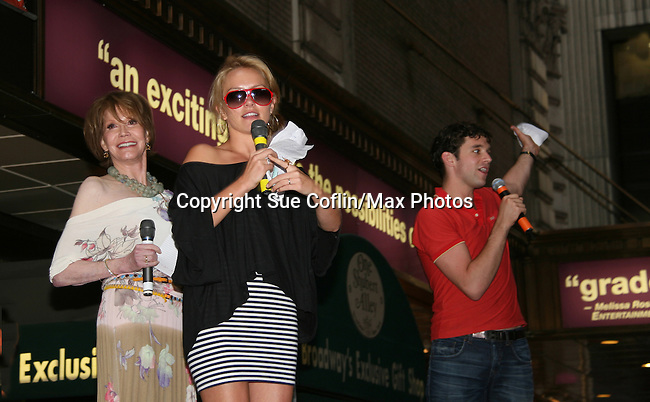 """Ugly Betty's Michael Urie and Becky Newton on stage with hostMary Tyler Moore at Broadway Barks 11 - a """"Pawpular"""" star-studded dog and cat adopt-a-thon on July 11, 2009 in Shubert Alley, New York City, NY. (Photo by Sue Coflin/Max Photos)"""