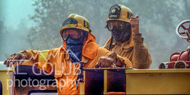 August 17, 1992 Angels Camp, California -- Old Gulch Fire— Los Angeles County firefighters wait on truck for orders.  The Old Gulch Fire raged over some 18,000 acres, destroying 42 homes while threatening the Mother Lode communities of Murphys, Sheep Ranch, Avery and Forest Meadows.