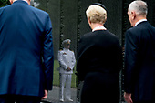 Navy Lt. Jack McCain, the son of, Sen. John McCain, R-Ariz., is reflected in the wall of the Vietnam Memorial as Jack's mother, Cindy McCain, accompanied by Defense Secretary Jim Mattis, right, and President Donald Trump's Chief of Staff John Kelly, left, departs after laying a wreath at the Vietnam Veterans Memorial in Washington, Saturday, Sept. 1, 2018, during a funeral procession to carry the casket of her husband from the U.S. Capitol to National Cathedral for a Memorial Service. McCain served as a Navy pilot during the Vietnam War and was a prisoner of war for more than five years.<br /> Credit: Andrew Harnik / Pool via CNP