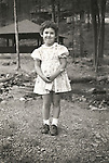 Kirsten Wild in dress, age 4. Forkesville, PA. File #73-139-12a.