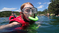 NWA Democrat-Gazette/FLIP PUTTHOFF<br /> A LOOK DOWN UNDER<br /> Kenlee Morris, 10, (left) explores the underwater world at Beaver Lake on Wednesday August 12 2015 during a snorkeling tour offered by Hobbs State Park-Conservation Area. Snorkelers traveled in the park's pontoon boat to a scenic cove in the Rocky Branch area of Beaver Lake and explored along a rocky shoreline. The park's next snorkeling trip is August 19 from 1 to 4 p.m. The $20 cost includes use of a snorkel, mask and life jacket. Call the Hobbs visitor center, 479-789-5000 to register.