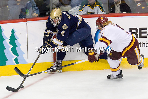 Riley Sheahan (Notre Dame - 4), Trent Palm (Duluth - 5) - The University of Minnesota-Duluth defeated the University of Notre Dame Fighting Irish 4-3 in their 2011 Frozen Four Semi-Final on Thursday, April 7, 2011, at the Xcel Energy Center in St. Paul, Minnesota.