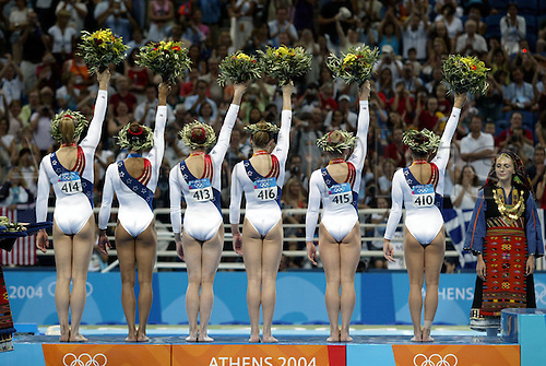 17 August 2004: The American Team celebrate on the podium after winning the Silver medal in the Women's Artistic Gymnastics Team Final in the Olympic Indoor Hall at the 2004 Olympic Games, Athens, Greece. Photo: Neil Tingle/Action Plus....040817 olympics womens women woman ladies.USA win winners podiums .celebrate celebration celebrating joy.