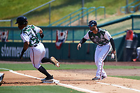 Lake Elsinore Storm hitting coach Felipe Blanco (20) waves Luis Campusano (4) to second base during a California League game against the Inland Empire 66ers on April 14, 2019 at The Diamond in Lake Elsinore, California. Lake Elsinore defeated Inland Empire 5-3. (Zachary Lucy/Four Seam Images)
