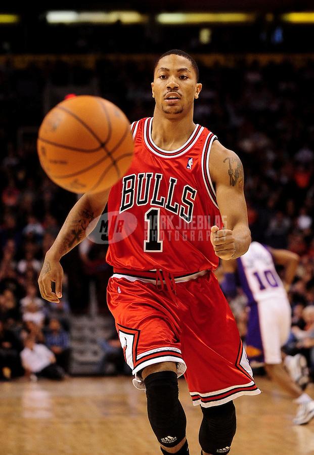 Jan. 22, 2010; Phoenix, AZ, USA; Chicago Bulls guard (1) Derrick Rose against the Phoenix Suns at the US Airways Center. Chicago defeated Phoenix 115-104. Mandatory Credit: Mark J. Rebilas-