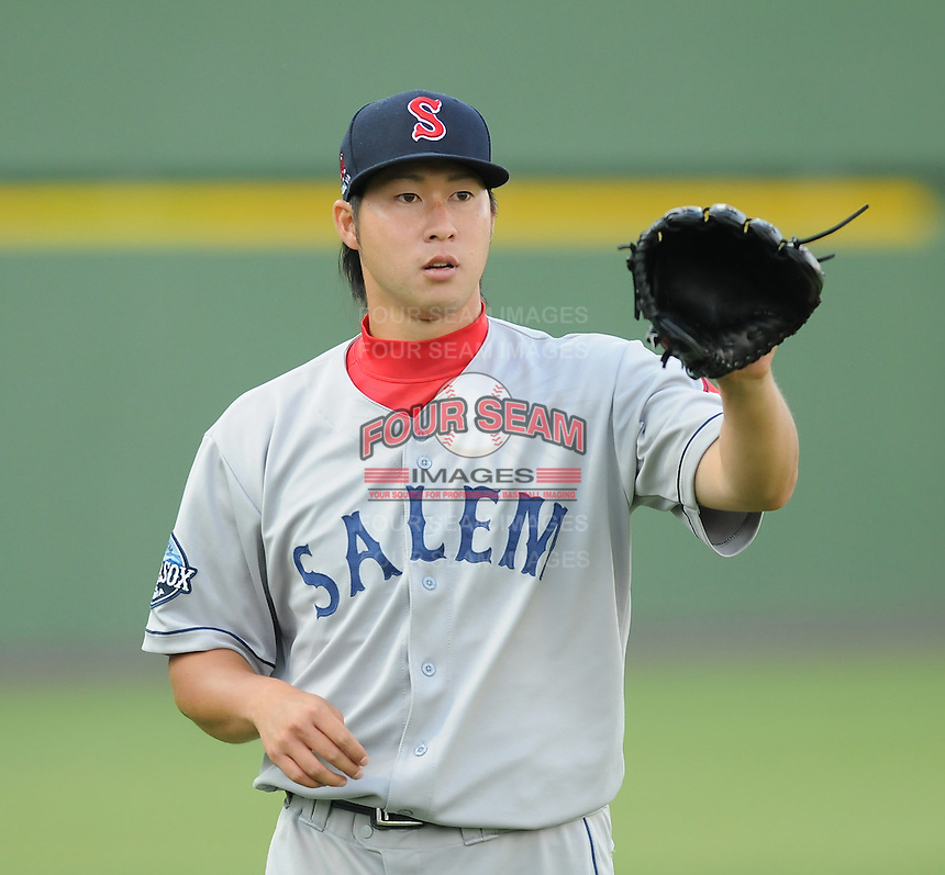 Starting pitcher Junichi Tazawa (13) of the Salem Red Sox prior to a game against the Potomac Nationals on June 16, 2011, at Pfitzner Stadium in Woodbridge, Va. Tazawa was on a Major League rehab assignment from the Boston Red Sox. (Tom Priddy/Four Seam Images)