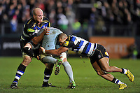 Matt Garvey and Jonathan Joseph of Bath Rugby put in a double-tackle. Aviva Premiership match, between Bath Rugby and Northampton Saints on December 5, 2015 at the Recreation Ground in Bath, England. Photo by: Patrick Khachfe / Onside Images