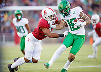 STANFORD, CA - SEPTEMBER 21: Curtis Robinson #2 of the Stanford Cardinal attempts to tackle Spencer Webb #18 of the Oregon Ducks during a game between University of Oregon and Stanford Football at Stanford Stadium on September 21, 2019 in Stanford, California.
