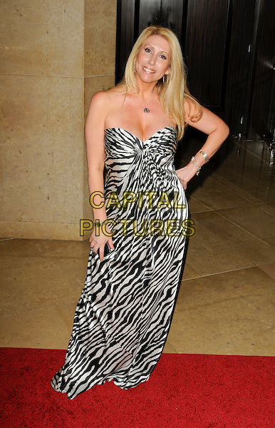 STEPHANIE MICHELS .arriving at Operation Smile at the Beverly Hilton Hotel in Beverly Hills, California, USA, October 2nd 2009..full length strapless black and white dress long maxi print hand on hip zebra animal .CAP/ROT.©Lee Roth/Capital Pictures.