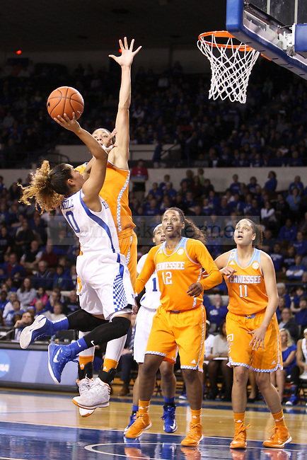 Kentucky guard Jennifer O'Neil takes a tough shot over the Tennessee defense during the second half of the UK Hoops versus Tennessee basketball game at Memorial Coliseum in Lexington , Ky., on Thursday, January 29, 2015. Tennessee won 73 - 72 over Kentucky. Photo by Jonathan Krueger | Staff