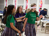 NWA Democrat-Gazette/CHARLIE KAIJO Stefany Mendoza, 13, Aubrey Holloway, 14 and Abigail Perry 13 (from left) play a blindfold game during a Pi Day celebration, Thursday, March 13, 2019 at St. Vincent de Paul Catholic School in Rogers. <br /><br />Students at St. Vincent de Paul Catholic School celebrates Pi Day with a pie eating contest, games and a pi&Atilde;&plusmn;ata. Pi Day is an annual celebration of the mathematical constant &Iuml;&euro;. Pi Day is observed on March 14 since 3, 1, and 4 are the first three significant digits of &Iuml;&euro;.<br /><br />&quot;[We're] giving the kids an opportunity to get out of the classroom, do something fun and incorporate math,&quot; said Amy Liddell, seventh and eighth grade math teacher.