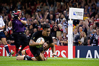 Julian Savea of New Zealand dives for the try-line. Rugby World Cup Pool C match between New Zealand and Georgia on October 2, 2015 at the Millennium Stadium in Cardiff, Wales. Photo by: Patrick Khachfe / Onside Images
