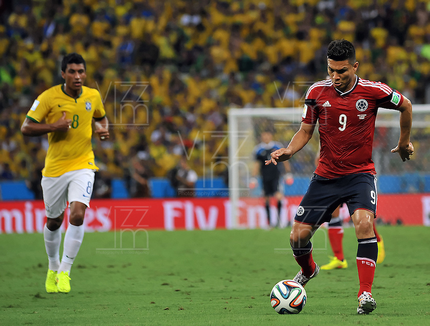FORTALEZA - BRASIL -04-07-2014. Teofilo Gutierrez (#9) jugador de Colombia (COL) en acción durante partido de los cuartos de final  Brasil (BRA) por la Copa Mundial de la FIFA Brasil 2014 jugado en el estadio Castelao de Fortaleza./ Teofilo Gutierrez (#9) player of Colombia (COL) in action during the match of the Quarter Finals against Brazil (BRA) for the 2014 FIFA World Cup Brazil played at Castelao stadium in Fortaleza: Photo: VizzorImage / Alfredo Gutiérrez / Contribuidor