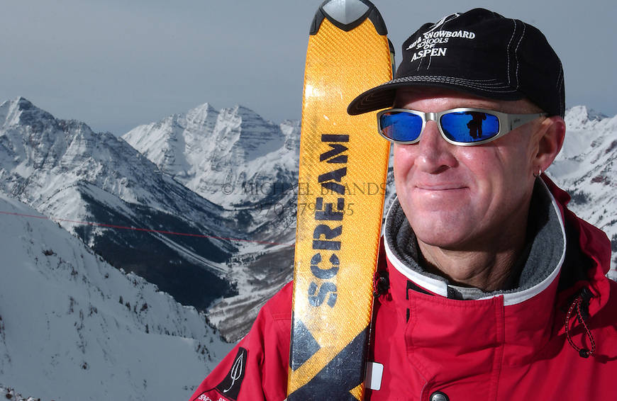 Ski instructor Paul Wade at the top of Aspen Highlands bowl. Maroon Bells and Elk Mountain range in the background. © Michael Brands. 970-379-1885.