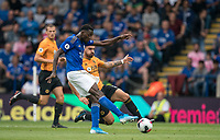 Wilfred Ndidi of Leicester City hits a shot at goal under pressure from Rubén Neves of Wolves during the Premier League match between Leicester City and Wolverhampton Wanderers at the King Power Stadium, Leicester, England on 10 August 2019. Photo by Andy Rowland.