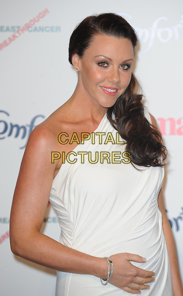 Michelle Heaton.Prima High Street Fashion Awards, Battersea Evolutions, Battersea Park, London, England..September 8th, 2011.half length white one shoulder dress pregnant bracelet.CAP/WIZ.© Wizard/Capital Pictures.