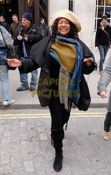 "MARY WILSON ( of The Supremes ).Leaving BBC Radio 4 after doing an interview on the Clive Anderson show ""Loose Ends"". The 64 year-old then signed some autographs before sprinting off down the road so fast that she nearly lost her hat!.London, England, February 28th 2009..full length cream beige hat black rain coat knee high boots blue scarf hands green grey gray wrap shawl .CAP/IA.©Ian Allis/Capital Pictures"