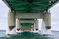 An early winter view of the underside of the Mackinac Bridge. Veins of ice coat the concrete pillars creating a unique scene to this engineering marvel. Mackinaw City, MI
