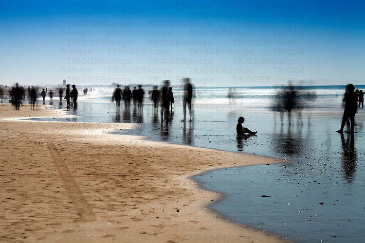 People on the beach. Daylight long exposure shot by the use of neutral density filters.