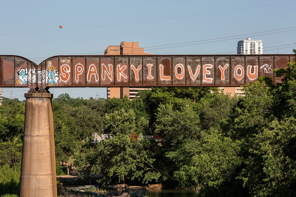 """""""Spanky I Love You"""" is a simplistic inspired declaration of love through a graffiti painting on Austin's Railroad Graffiti Bridge over Lady Bird Lake in downtown Austin, Texas - Stock image."""