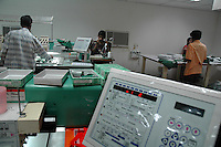 Workers at Prime Tex Industries. Advanced sophisticated machies are now used in the factories of Tirupur to meed the rising demand of their products, Tamilnadu. After lifting of quota system in textile export on 1st january 2005. Tirupur has become the biggest foreign currency earning town of India.