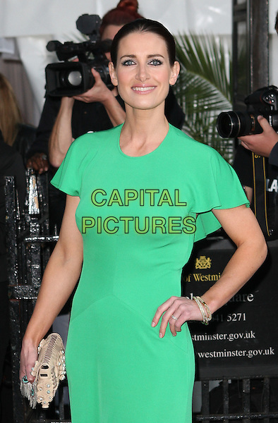 Kirsty Gallacher.Glamour Women Of The Year Awards held at Berkeley Square Gardens, London, England..June 7th 2011.outside arrivals half length green dress hand on hip clutch bag .CAP/ROS.©Steve Ross/Capital Pictures