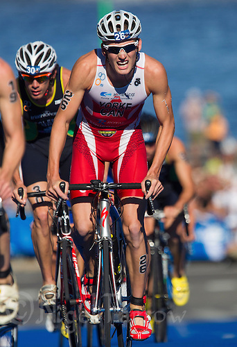 25 AUG 2013 - STOCKHOLM, SWE - Andrew Yorke (CAN) of Canada climbs a hill during the bike at the men's ITU 2013 World Triathlon Series round in Gamla Stan, Stockholm, Sweden (PHOTO COPYRIGHT © 2013 NIGEL FARROW, ALL RIGHTS RESERVED)
