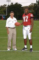 7 August 2006: Stanford Cardinal head coach Walt Harris and Emmanuel Awofadeju during Stanford Football's Team Photo Day at Stanford Football's Practice Field in Stanford, CA.