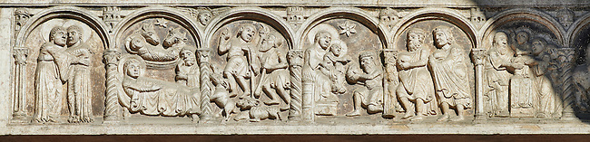 Scenes from the life of Christ - From Left, The Nativity, The shepherds, The coming of the Kings,  - the work of the sculptor Nicholaus, on the main portal  of the 12th century Romanesque Ferrara Duomo, Italy