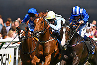 Neshmeya ridden by Jim Crowley blue/white cap and trained by Charles Hills start their run to win The Wateraid Mildren Construction Maiden Fillies' Stakes (Plus 10) during Father's Day Racing at Salisbury Racecourse on 18th June 2017