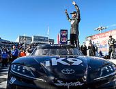 #18: Kyle Busch, Joe Gibbs Racing, Toyota Supra Extreme Concepts/iK9, celebrates after winning the NASCAR Xfinity Series race.