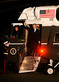 Washington, DC - November 11, 2008 -- United States President George W. Bush waves as he arrives at the White House, following a day trip to New York where he precipitated in a Veteran's Day rededication ceremony of the U.S.S. Intrepid, in Washington on Tuesday, November 11, 2008. <br /> Credit: Kevin Dietsch - Pool via CNP